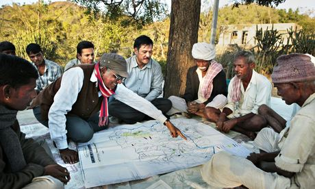 Director Well for India examines a map