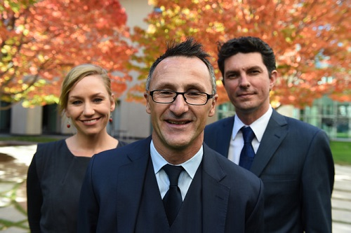 Newly elected Federal Greens Leader Richard Di Natale (centre) and his leadership team Scott Ludlam (right) and Larissa Waters (left) at a photo opportunity after Christine Milne resigned as Greens leader at Parliament House in Canberra, Wednesday, May 6, 2015. (AAP Image/Mick Tsikas) NO ARCHIVING